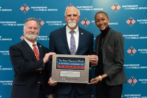 WASHINGTON, D.C. (Dec. 12, 2018) (From L to R) Deputy Director, Field Operations Gary Hattal, Acting Director Rich Giacolone and Change Management Advisor Traci Coddington accept a plaque recognizing the Federal Mediation and Conciliation Service (FMCS) as the Best Place to Work in the Federal Government (Small Agency category) for 2018. (Photo courtesy of Partnership for Public Service)